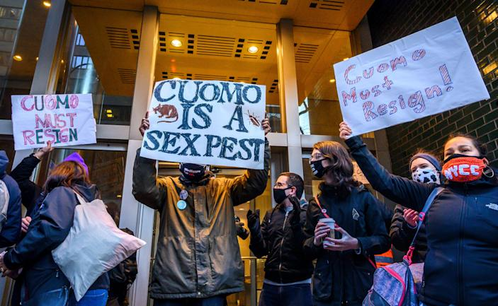 Demonstrators rally for New York Gov. Andrew Cuomo's resignation in front of his Manhattan office in New York, Tuesday, March 2, 2021.