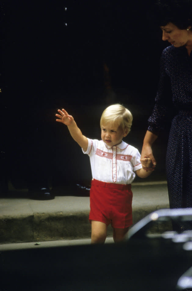 Prince William leaves the Lindo Wing of St. Mary's Hospital with his nanny Barbara Barnes after visiting his newborn brother Prince Harry on September 15, 1984 in London, England.
