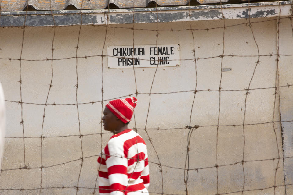 A female prisoner is seen inside the prison premises at Chikurubi prison on the outskirts of Harare, Saturday, April 17, 2021. Zimbabwe began the release of about 3,000 prisoners under a presidential amnesty aimed at easing congestion and minimizing the threat of COVID-19 across the country's overcrowded jails. (AP Photo/Tsvangirayi Mukwazhi)