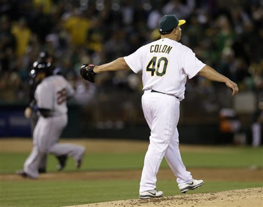 Oakland Athletics' Bartolo Colon (40) waits for Detroit Tigers' Prince Fielder to run the bases, left, after Fielder hit a three-run home run off him in the third inning of a baseball game on Friday, April 12, 2013, in Oakland, Calif. (AP Photo/Ben Margot)
