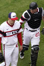 Chicago White Sox catcher Zack Collins, right, talks to relief pitcher Garrett Crochet as they walk to the dugout during the 10th inning of a baseball game against the Kansas City Royals in Chicago, Sunday, April 11, 2021. (AP Photo/Nam Y. Huh)