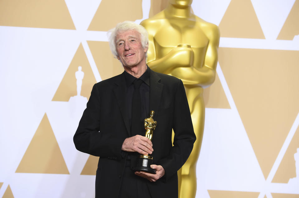 """Roger Deakins, winner of the award for best cinematography for """"Blade Runner 2049"""", poses in the press room at the Oscars on Sunday, March 4, 2018, at the Dolby Theatre in Los Angeles. (Photo by Jordan Strauss/Invision/AP)"""