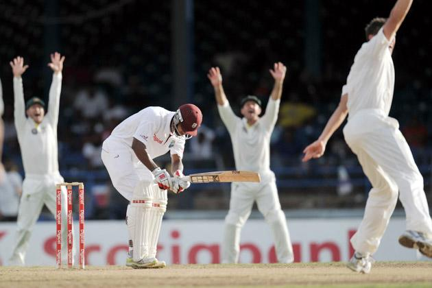 West Indies bowler Kemar Roach (R) celebrates the wicket of Australian batsman Ben Hilfenhausdur (L) during the second day of the second-of-three Test matches between Australia and West Indies April 16, 2012 at Queen's Park Oval in Port of Spain, Trinidad. AFP PHOTO/Stan HONDA