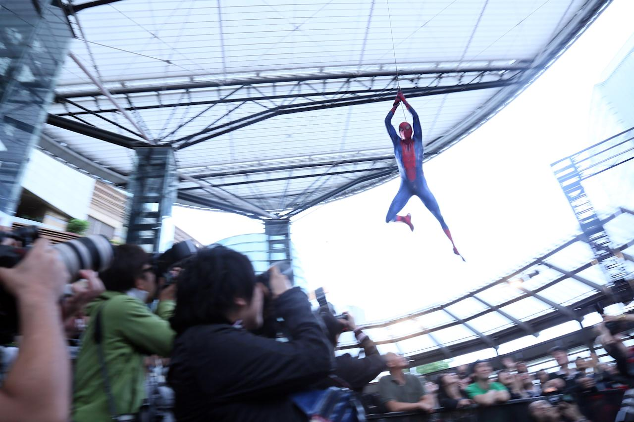 TOKYO, JAPAN - JUNE 13:  A performer flies over the media during the world Premiere of 'The Amazing Spider-Man' at Roppongi Hills on June 13, 2012 in Tokyo, Japan. The film will open on June 30 in Japan.  (Photo by Ken Ishii/Getty Images)