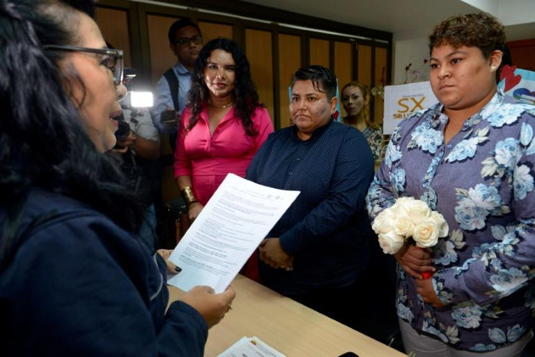 Ecuador's highest court approved same-sex marriage in a historic June 12 decision that sparked protests in the conservative Catholic country (AFP Photo/Marcos PIN)