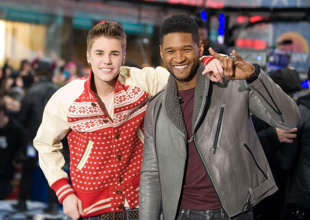 """One of the Biebs' besties, crooner Usher, joined the heartthrob on a version of """"The Christmas Song (Chestnuts Roasting On An Open Fire)."""" Judging by the screams from the crowd, they were pleasantly surprised! (11/23/2011)"""