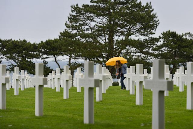 <p>Visitors view the graves of fallen soldiers at the Normandy American Cemetery. (Photo: Artur Widak/NurPhoto via Getty Images) </p>
