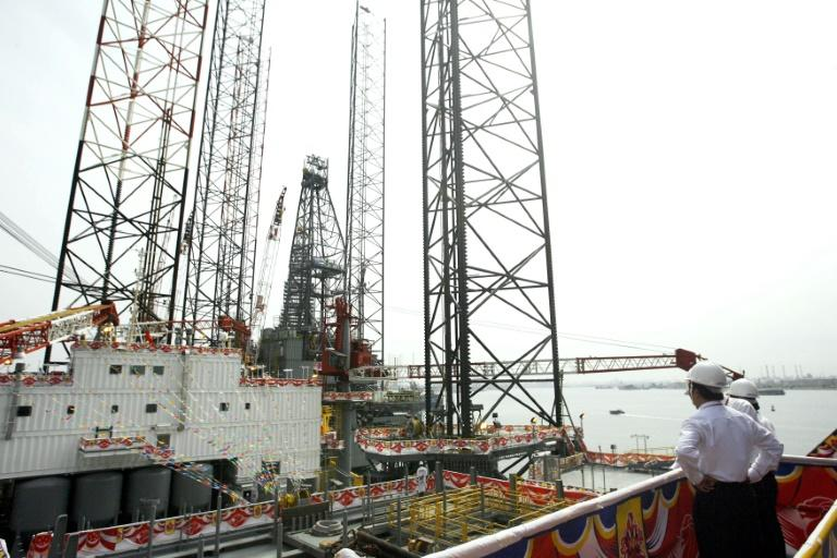 Graft penalty pushes Keppel into quarterly loss; full-year gain down 72%