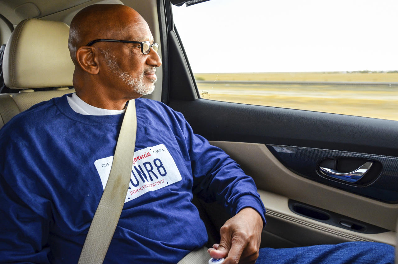 This Oct. 3, 2018 photo provided by California Innocence Project shows Horace Roberts looking out the window of a car after being released from Avenal State Prison in Avenal, Calif. Roberts, wrongly convicted of murdering his lover two decades ago has been exonerated and new arrests have been made in the case. (California Innocence Project via AP)