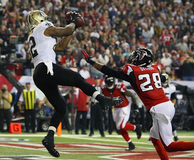 Saints tight end Benjamin Watson catches a touchdown pass as Falcons safety Thomas DeCoud defends during the first half of an NFL football game, Thursday, Nov. 21, 2013 in Atlanta. (AP Photo/Atlanta Journal-Constitution, Curtis Compton)