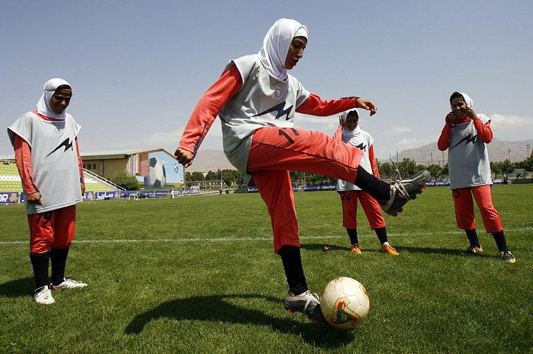 Players of Iran's women national football team warm up in 2009
