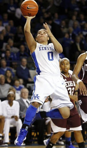 Kentucky's Jennifer O'Neill (0) shoots in front of Texas A&M's Adrienne Pratcher (32) during the first half of an NCAA college basketball game at Memorial Coliseum in Lexington, Ky., Thursday, Jan. 10, 2013. (AP Photo/James Crisp)