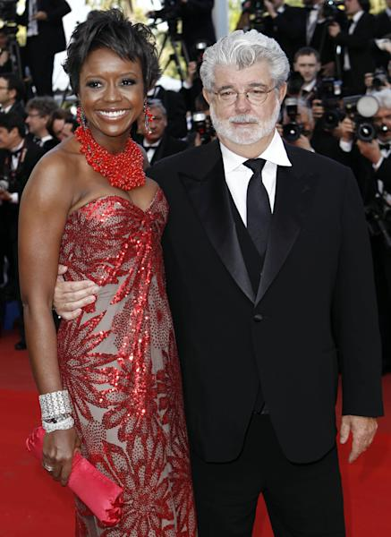 "In this May 14, 2010 photo, Filmmaker George Lucas, right, and Mellody Hobson arrive for the screening of ""Wall Street Money Never Sleeps"", at the 63rd international film festival, in Cannes, southern France. A spokeswoman for Lucasfilm said on Thursday, Jan. 3, 2013, the 68-year-old director is engaged to 43-year-old investment firm president Mellody Hobson. (AP Photo/Matt Sayles, File)"