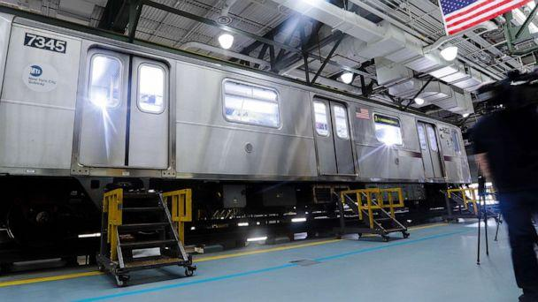 PHOTO: Members of the media witness a demonstration of new measures involving UV-C light technology to disinfect a subway car during the coronavirus pandemic at the Corona Maintenance Facility, May 19, 2020, in the Queens borough of New York. (Frank Franklin II/AP)
