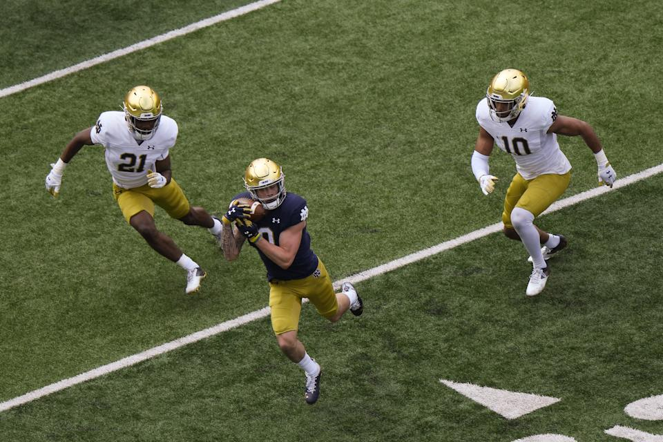 SOUTH BEND, INDIANA - MAY 01: Braden Lenzy #0 of the Notre Dame Fighting Irish catches the football against Caleb Offord #21 and Isaiah Pryor #10 of the Notre Dame Fighting Irish Blue-Gold Spring Game at Notre Dame Stadium on May 01, 2021 in South Bend, Indiana. (Photo by Quinn Harris/Getty Images)