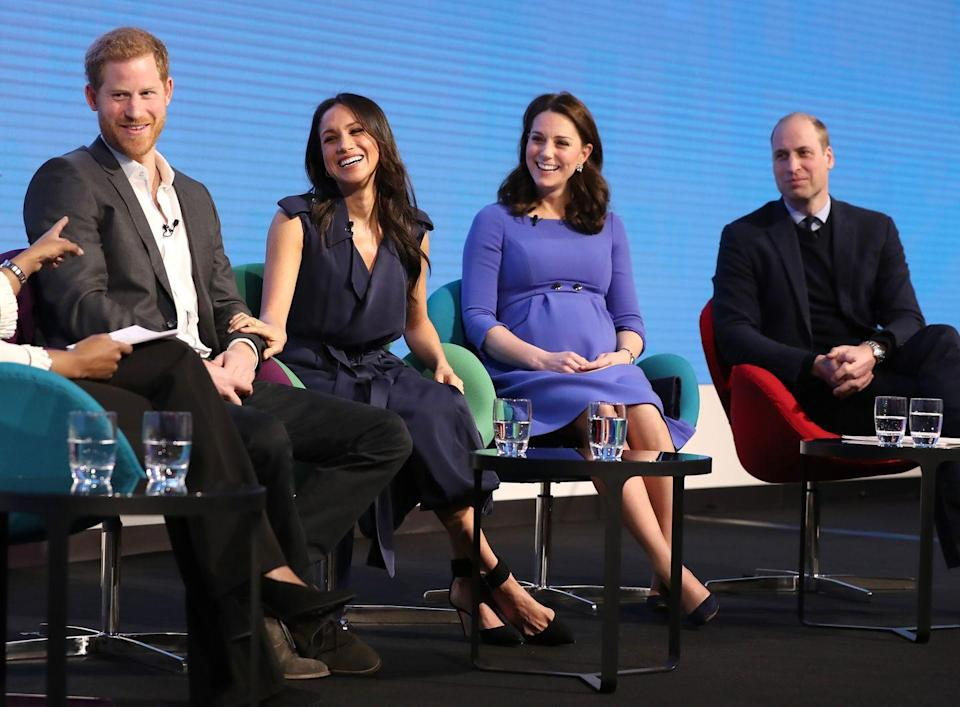 <p>Markle couldn't help but place a loving hand on her then fiancé's arm she appeared at her first public event with Prince Harry, Kate Middleton and Prince William at the first annual Royal Foundation Forum, February 2018. </p>
