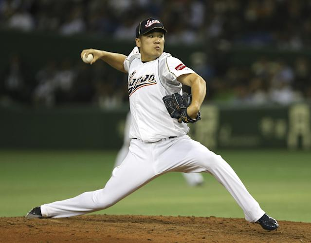 Japan's Masahiro Tanaka pitches against the Netherlands in the fifth inning of their World Baseball Classic second round game at Tokyo Dome in Tokyo, Tuesday, March 12, 2013. (AP Photo/Toru Takahashi)