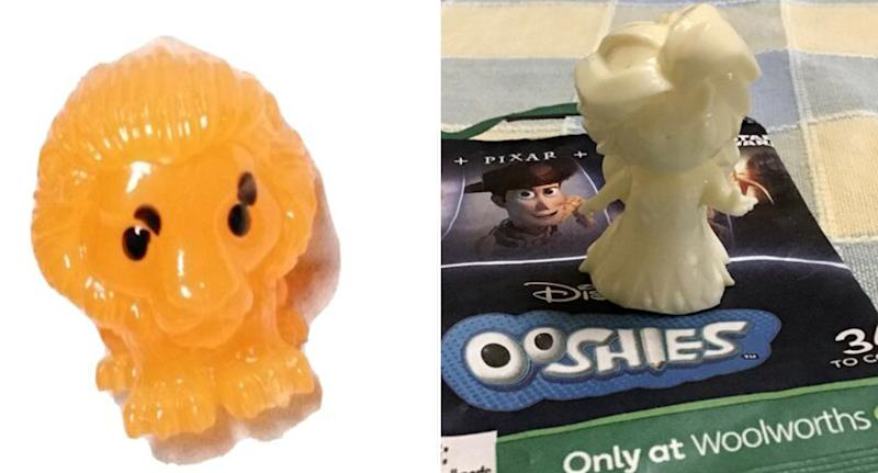 A Simba Woolworths Ooshie is pictured with four eyes alongside a rare white Elsa Ooshie.
