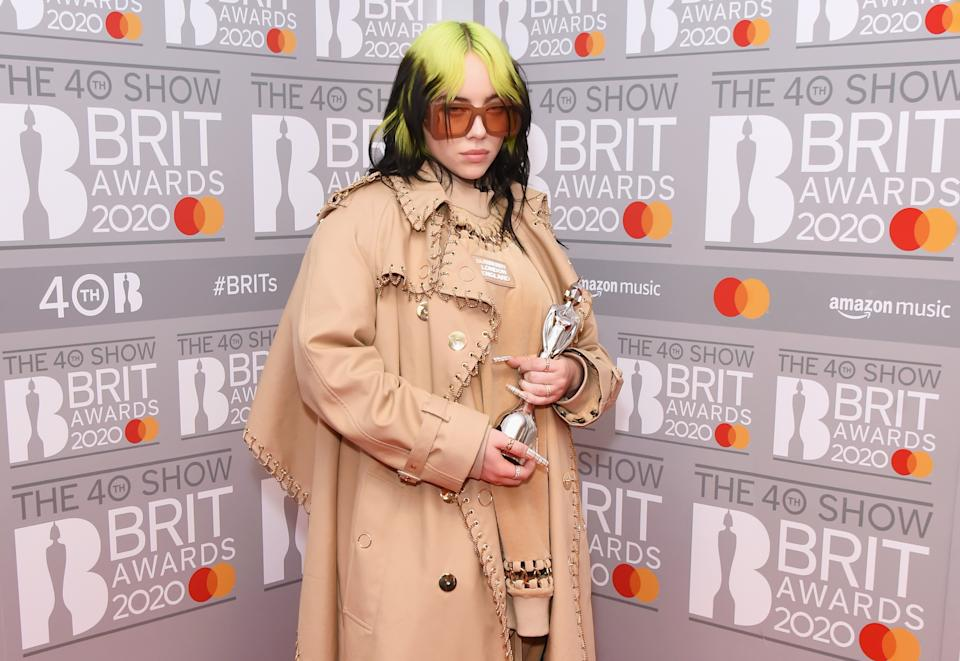 LONDON, ENGLAND - FEBRUARY 18: (EDITORIAL USE ONLY)  Billie Eilish, winner of the Best International Female Solo Artist award, poses in the winners room at The BRIT Awards 2020 at The O2 Arena on February 18, 2020 in London, England.  (Photo by David M. Benett/Dave Benett/Getty Images)
