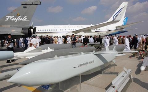 In this picture taken in 2005, visitors pass behind the French made Storm Shadow/Scalp EG cruise missiles - Credit: Rabih Moghrabirabih/AFP
