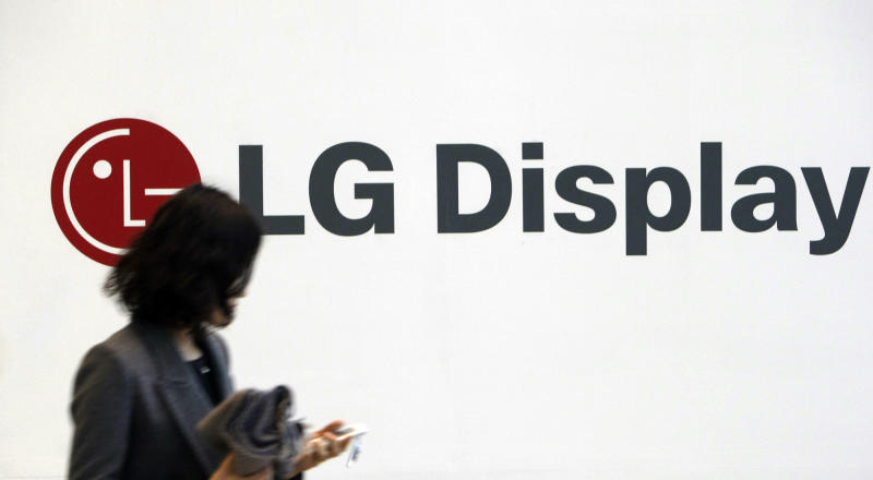 In this photo taken on Jan. 20, 2010, a woman walks past near the LG Display advertisement in Seoul, South Korea. LG Display Co., the world's second-largest maker of liquid crystal displays, Tuesday, April 24, 2012, reported its third straight quarterly loss due to feeble demand for TVs. (AP Photo/Lee Jin-man)