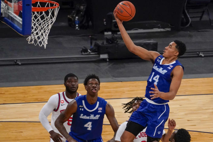 Seton Hall guard Jared Rhoden (14) goes to the basket during the first half of an NCAA college basketball game against St. John's in the quarterfinals of the Big East conference tournament, Thursday, March 11, 2021, in New York. (AP Photo/Mary Altaffer)