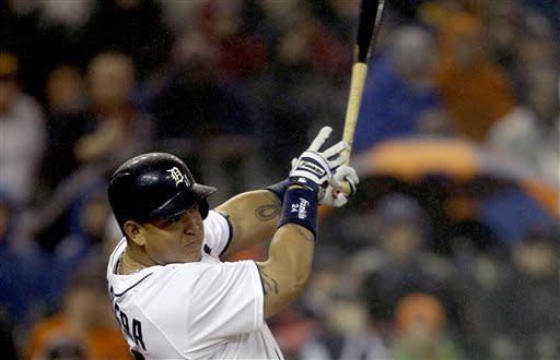 Detroit Tigers' Miguel Cabrera connects for a three-run home run during the seventh inning of a baseball game against the Atlanta Braves in Detroit, Sunday, April 28, 2013. (AP Photo/Carlos Osorio)