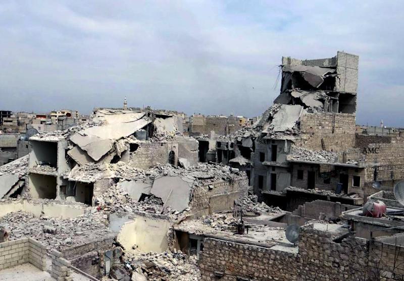 This citizen journalism image provided by Aleppo Media Center AMC which has been authenticated based on its contents and other AP reporting, shows destroyed homes in a government airstrike and shelling, in the neighborhood of Marjeh in the northern city of Aleppo, Syria, Thursday, April. 11, 2013. A U.S.-based rights group on Thursday accused Syria of war crimes by indiscriminate and sometimes deliberate airstrikes against civilians, killing at least 4,300 people since last summer. (AP Photo/Aleppo Media Center AMC)