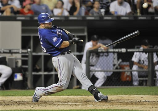 Texas Rangers' Mike Napoli breaks his bat as he flies out during the eighth inning of a baseball game against the Chicago White Sox, Wednesday, July 4, 2012, in Chicago. (AP Photo/Brian Kersey)