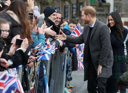 Meghan Markle and Britain's Prince Harry, meet members of the public during a walkabout on the esplanade at Edinburgh Castle, Britain, February 13, 2018. REUTERS/Andrew Milligan/Pool