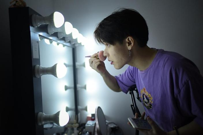 Jiang Cheng preparing for a male beauty video at his home in Beijing (AFP Photo/WANG ZHAO)
