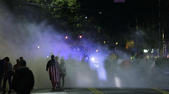<p>Smoke from a small fire and fire-extinguisher powder rises during a protest against President-elect Donald Trump, Wednesday, Nov. 9, 2016, in Seattle's Capitol Hill neighborhood. (Photo: Ted S. Warren/AP) </p>