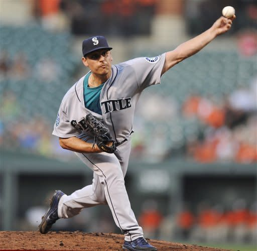 Seattle Mariners starting pitcher Jason Vargas delivers against the Baltimore Orioles in the second inning of a baseball game, Monday, Aug. 6, 2012, in Baltimore. (AP Photo/Gail Burton)