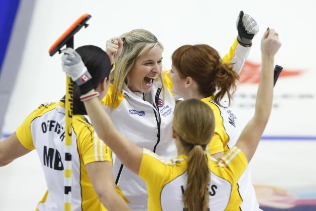 Manitoba skip Jennifer Jones (C) celebrates with her teammates second Jill Officer (L) lead Dawn McEwen and third Kaitlyn Lawes (R) after they defeated Alberta in the gold medal game during the Scotties Tournament of Hearts in Moose Jaw, Saskatchewan, February 22, 2015. REUTERS/Todd Korol (CANADA - Tags: SPORT CURLING)
