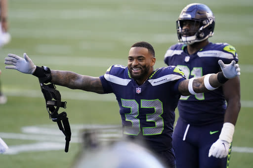 Adams, Dunbar out for Seahawks' trip to face Dolphins