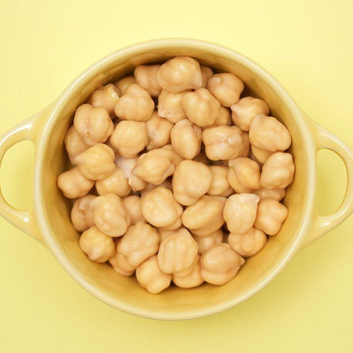 """<p>Chickpeas aren't just a solid source of protein — they're also a great option to eat if you need to lower your cholesterol. """"One <a href=""""https://www.ncbi.nlm.nih.gov/pmc/articles/PMC4016088/"""" rel=""""nofollow noopener"""" target=""""_blank"""" data-ylk=""""slk:study"""" class=""""link rapid-noclick-resp"""">study</a> found that eating pulses, like lentils and dried peas, daily significantly lowered bad 'LDL' cholesterol levels by about 5 percent,"""" says Gorin. """"One of my favorite way to eat pulses is roasting chickpeas.""""</p>"""