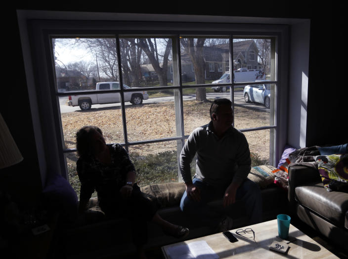 Addie and Bob Harte sit in the window and talk about the day, last April, when police raided their home in Leawood, Kan., Friday, March 29, 2013. The Hartes, who are former CIA employees, sued this week to get more information about why sheriff's deputies searched their home in the upscale Kansas City suburb last April 20 as part of Operation Constant Gardener — a sweep conducted by agencies in Kansas and Missouri that netted marijuana plants, processed marijuana, guns, growing paraphernalia and cash from several other locations. (AP Photo/Orlin Wagner)