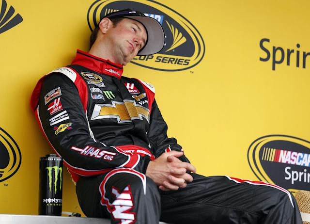 Driver Kurt Busch relaxes on stage after arriving from Indianapolis before the NASCAR Sprint Cup series Coca-Cola 600 auto race at Charlotte Motor Speedway in Concord, N.C., Sunday, May 25, 2014. Busch finished sixth in the Indianapolis 500 earlier in the day. (AP Photo/Chris Keane)