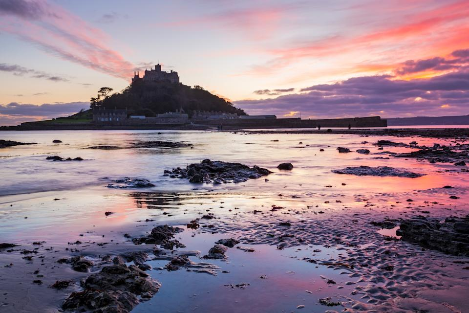 Sunset on the beach at Marazion with St Michaels Mount in the distance. (Getty Images)
