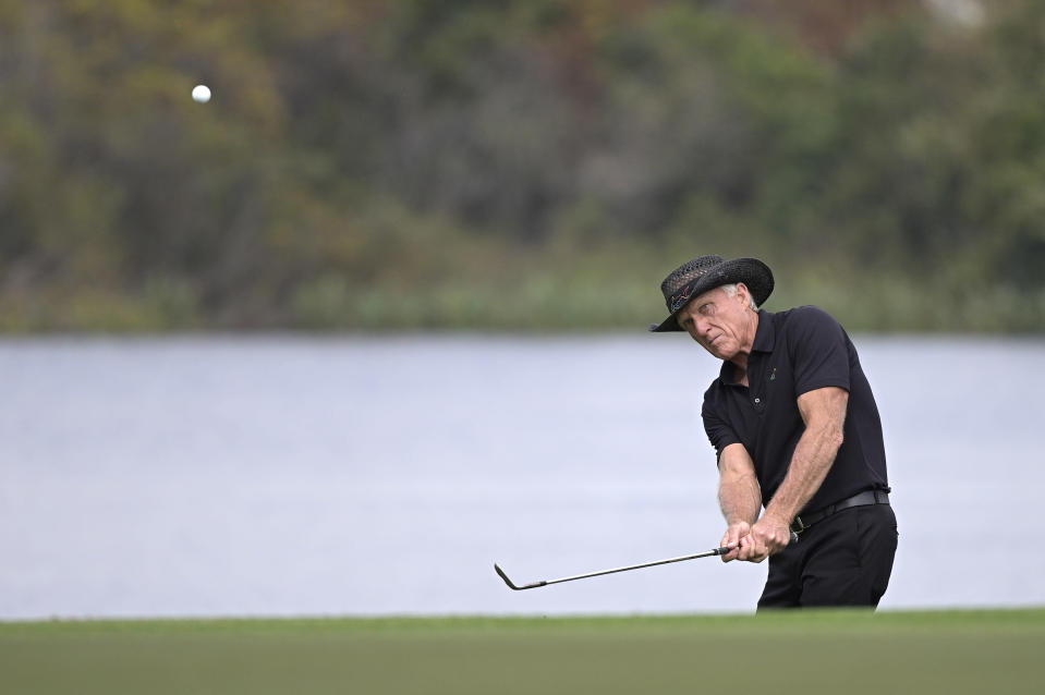 Greg Norman, of Australia, hits out of a bunker onto the 18th green during the final round of the PNC Championship golf tournament, Sunday, Dec. 20, 2020, in Orlando, Fla. (AP Photo/Phelan M. Ebenhack)