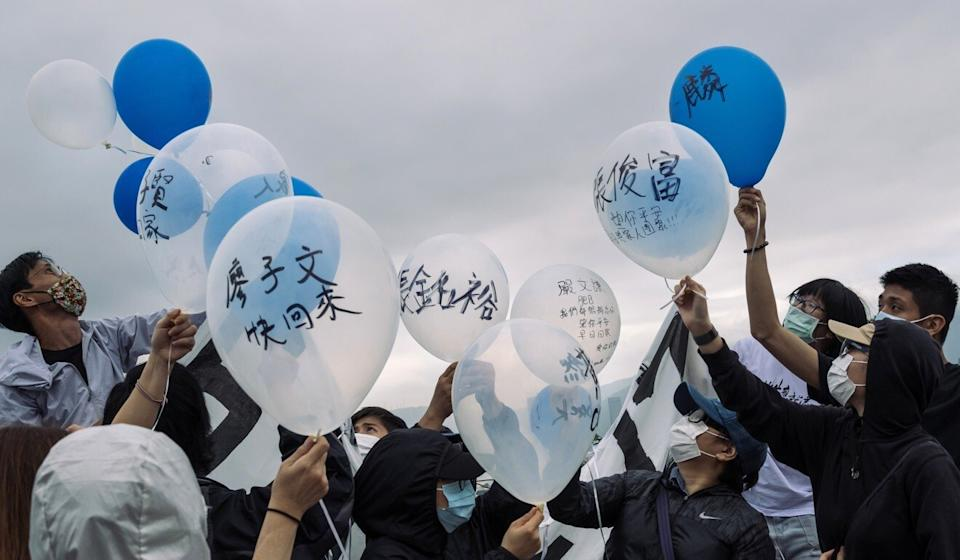 Family members of the Hong Kong fugitives detained in mainland China release balloons, marked with the names of the detainees, on Crooked Island in Hong Kong, on November 21, 2020. Photo: Bloomberg