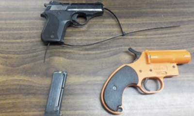 Mother Arrested After Son Takes Gun To School