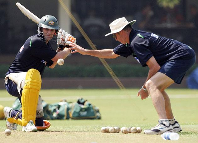 Adam Gilchrist of Australia is assisted with his batting by coach John Buchanan during training at Brabourne Stadium on October 13, 2006, in Mumbai, India.  (Photo by Hamish Blair/Getty Images)