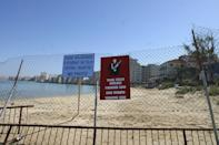 A general view of Famagusta's coast with the deserted hotels of the tourist area of Varosha in the background, fenced off out of bounds in the Turkish occupied north of the island 05 May 2003. For the past two weeks, Greek-Cypriots have been allowed to visit their villages and homes which they lost in 1974 in the Turkish military invasion of the northern part of the island. (Photo by Laura BOUSHNAK / AFP) (Photo by LAURA BOUSHNAK/AFP via Getty Images)