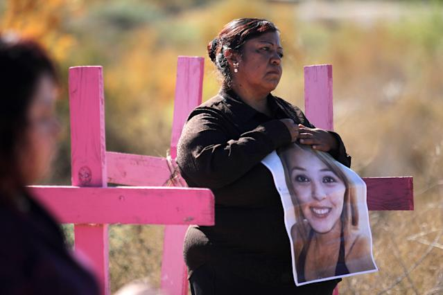 <p>Carmen Castillo (R) holds a picture of her daughter Monica Delgado -killed in 2012- during a protest on the eve of the International Day for the Elimination of Violence Against Women, on Nov. 24, 2017, in Juarez valley, near Ciudad Juarez, Chihuahua State, Mexico. (Photo: Herika Martinez/AFP/Getty Images) </p>