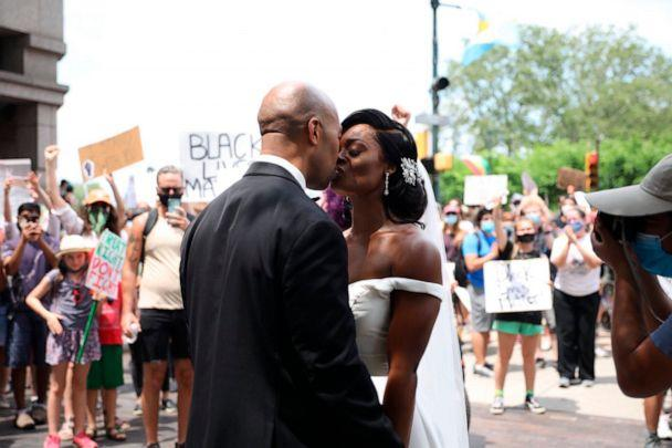 PHOTO: Kerry Anne and Michael Gordon came out to the crowd during a protest, June 6, 2020, in Philadelphia over the death of George Floyd. (Tyger Williams/AP)