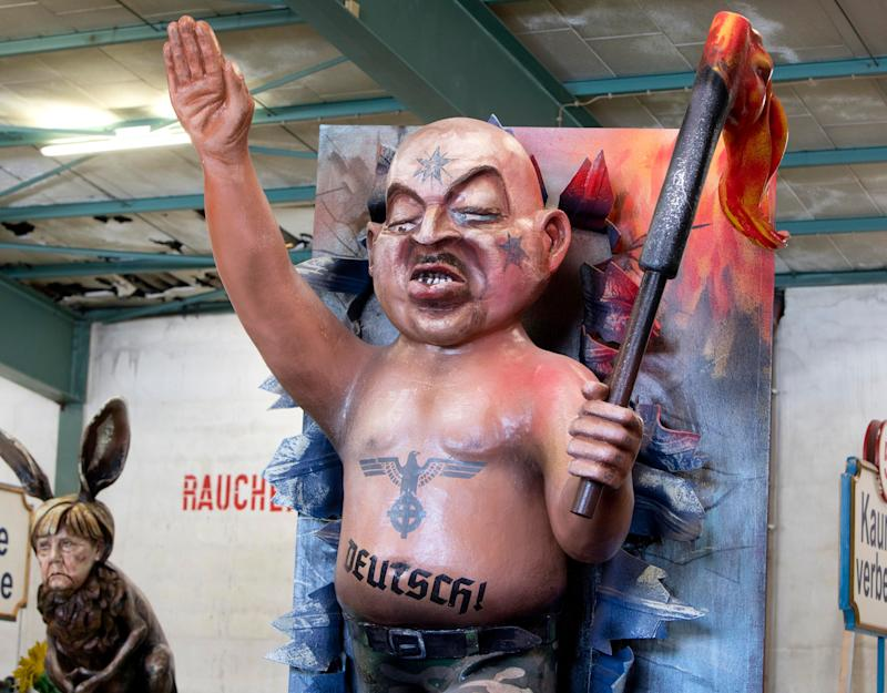 A figure depicting a German nazi is shown during a press preview in a hall of the Mainz carnival club in Mainz, Germany, Feb. 26, 2019. (Photo: Michael Probst/AP)
