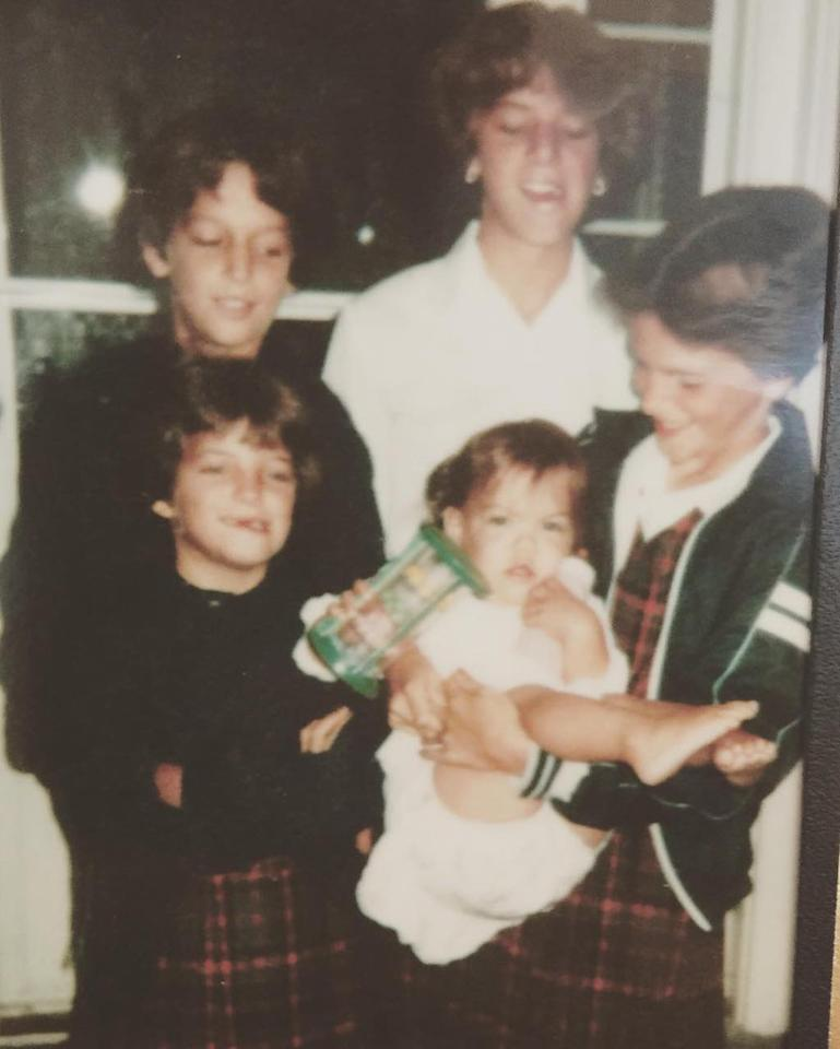 """<p>As the youngest of five children, Holmes obviously drew a lot of attention growing up. And even though she's not smiling in this photo, you can tell she was a cutie! (Photo: Katie Holmes via <a rel=""""nofollow"""" href=""""https://www.instagram.com/p/BSuNMHajUvT/?taken-by=katieholmes212&hl=en"""">Instagram</a>) </p>"""