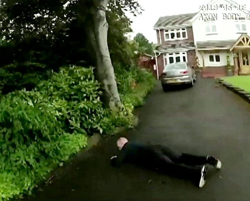 Body-cam footage of a ram raider being arerested in Hollywood, Worcestershire. (SWNS)