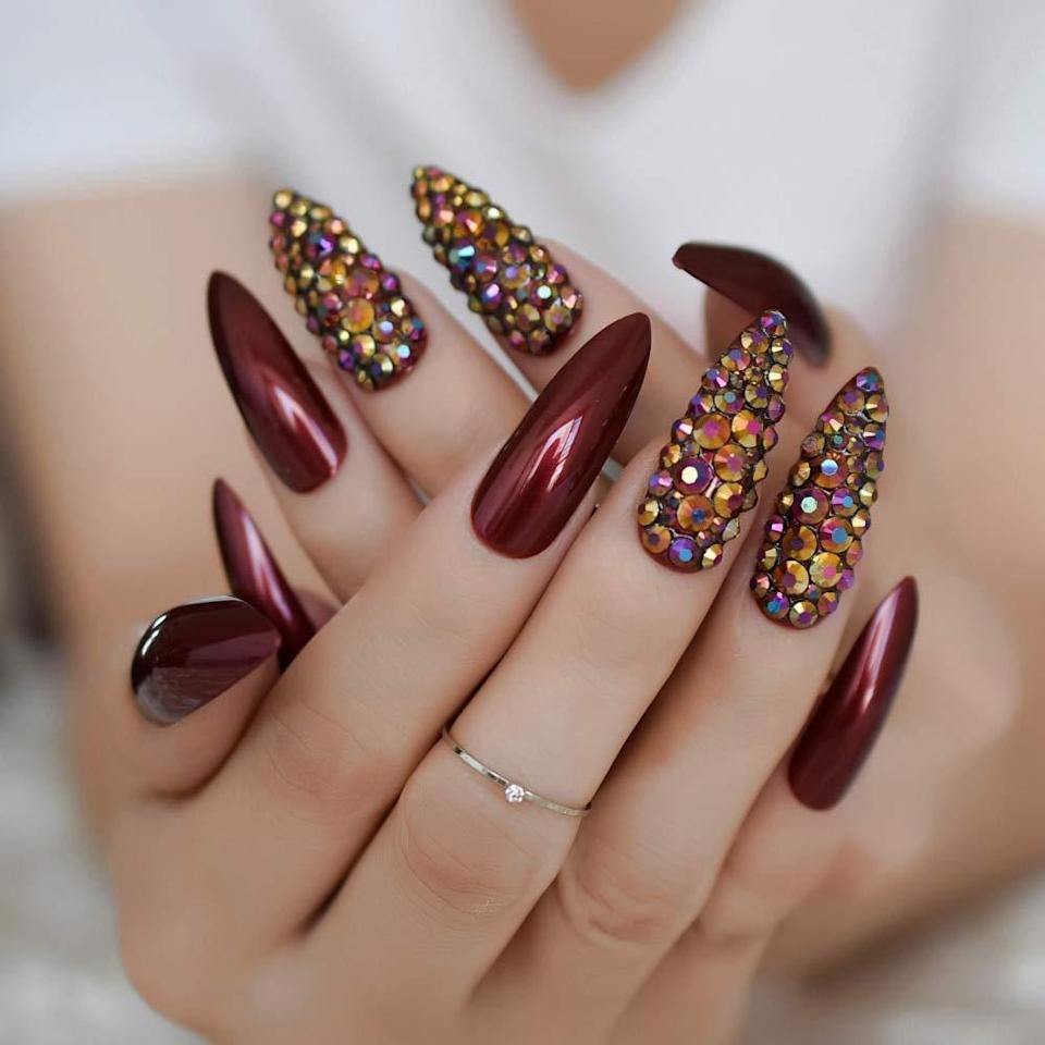 "<p>When we tapped professional nail artists for their <a href=""https://www.allure.com/story/nail-trends-2021?mbid=synd_yahoo_rss"" rel=""nofollow noopener"" target=""_blank"" data-ylk=""slk:2021 trend predictions"" class=""link rapid-noclick-resp"">2021 trend predictions</a>, embellished and pre-painted nails made the cut. For a truly dazzling look on the fly, check out CoolNail's Sharp False Nails for bejeweled, marbled, and ombré styles that will capture everyone's attention over Zoom. Each set comes with 24 nails and one sheet of double-sided adhesive tabs, which can be used in place of nail glue — but either works. </p> <p><strong>$7 to $13</strong> (<a href=""https://www.amazon.com/CoolNail-Metallic-Stilettos-Artificial-Stiletto/dp/B07Q6JJ4BM?th=1"" rel=""nofollow noopener"" target=""_blank"" data-ylk=""slk:Shop Now"" class=""link rapid-noclick-resp"">Shop Now</a>)</p>"